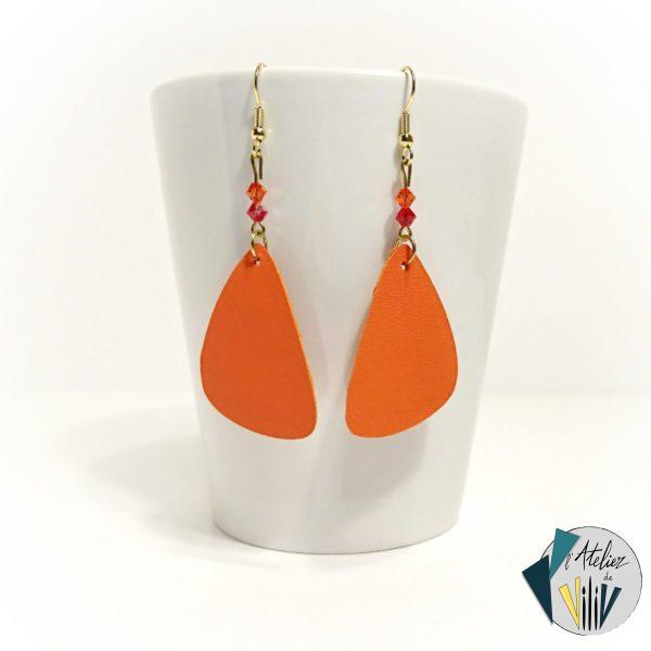 boucles asymétriques en cuir orange